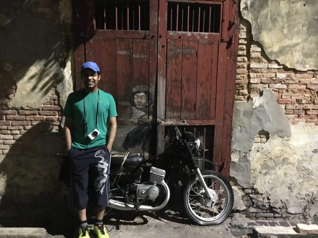 Boy_on_bike_in_penang_street_georgetown